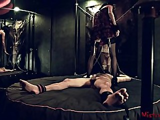 Mistress tortures chained..
